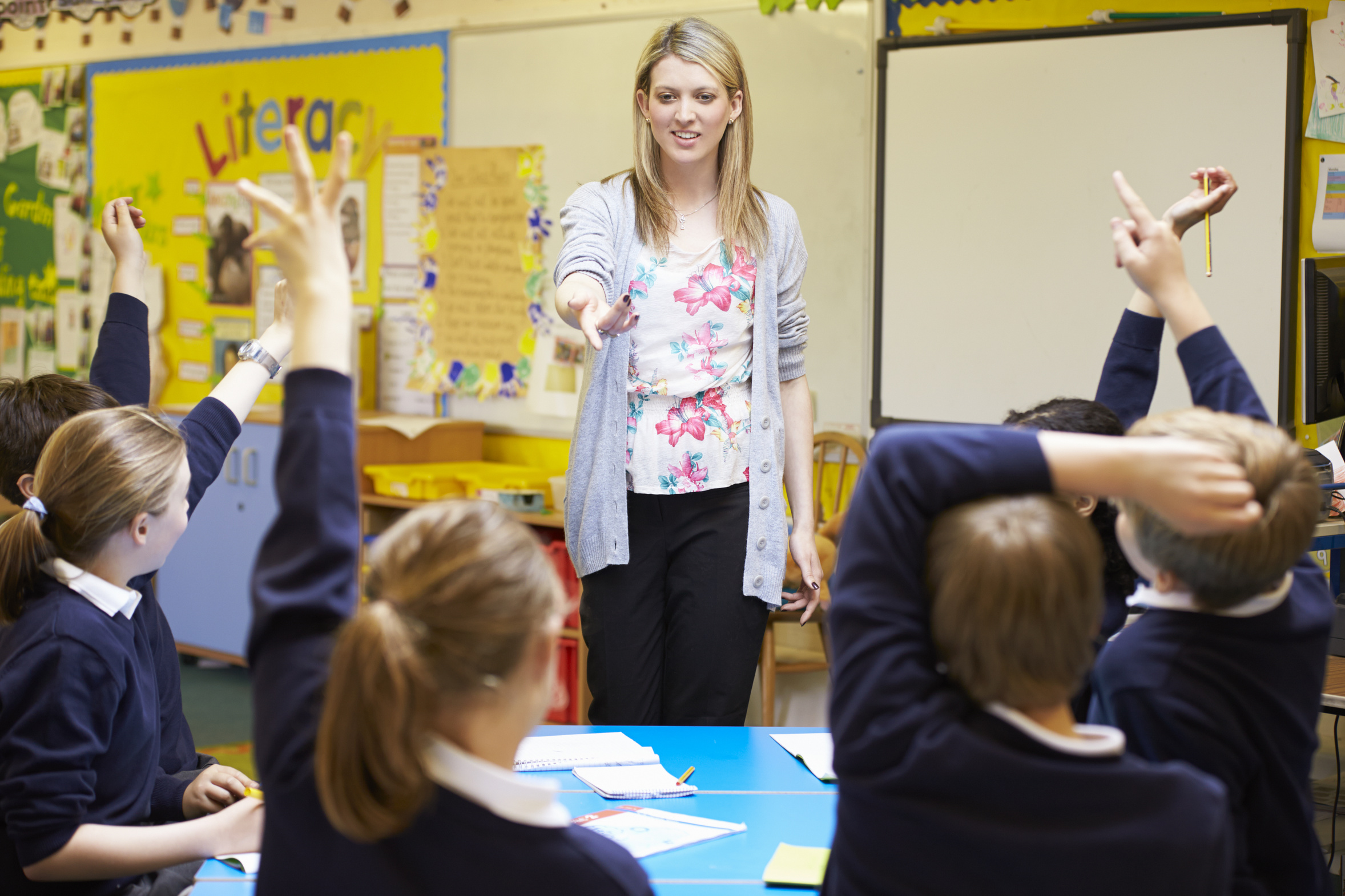 Teacher Teaching Lesson To Elementary School Pupils